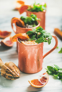 Blood orange Moscow mule alcohol cocktails in copper mugs