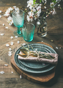 Spring Easter Table setting over vintage wooden background