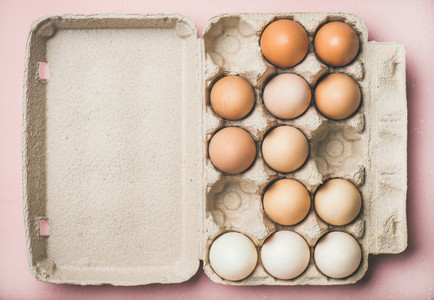 Natural colored eggs for Easter in box copy space