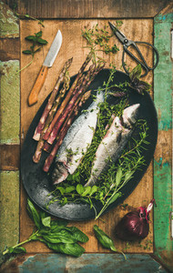 Raw incooked sea bass with herbs