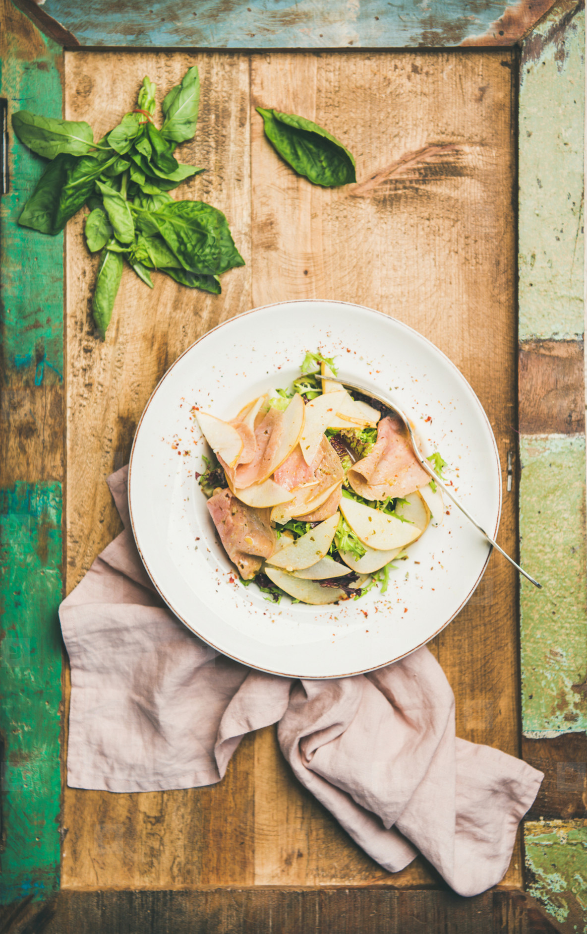 Fresh summer salad with smoked turkey ham and pear
