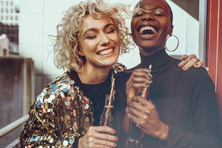 Laughing women friends enjoying themselves