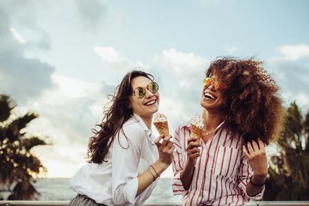 Girls having ice cream outdoors