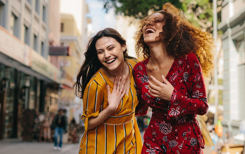 Girl friends having fun on city street