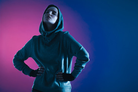 Sportswoman in hooded sweatshirt