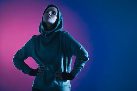 Sportswoman in hooded sweatshirt