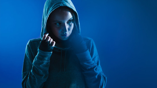 Fitness woman in hooded shirt