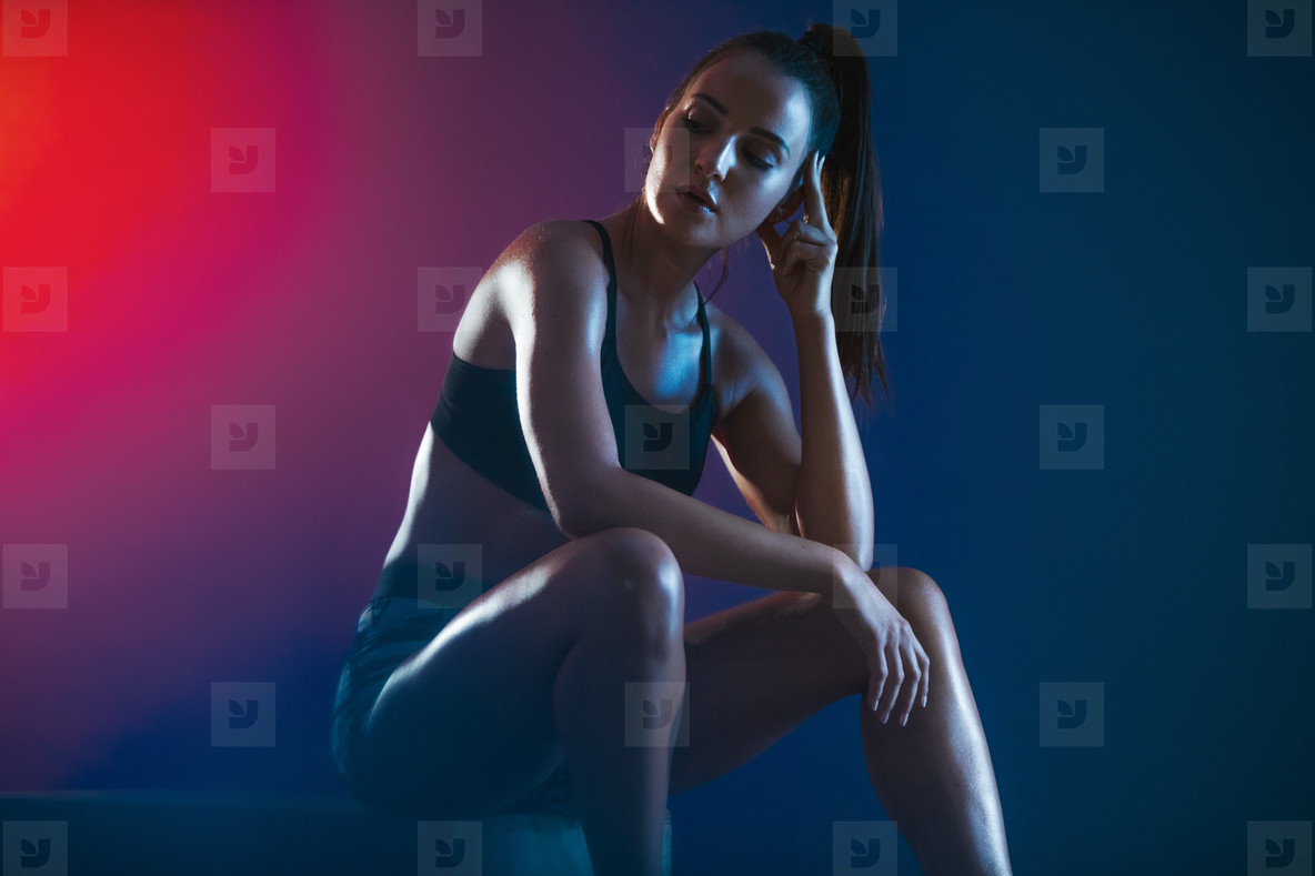 Sportswoman resting after workout