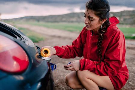 Girl preparing a tea before walk on the field