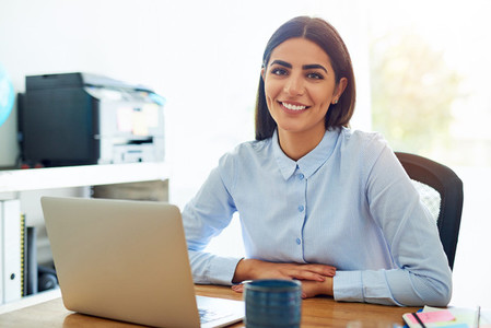 Smiling friendly young businesswoman