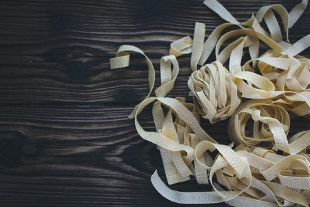 Pasta tagliatelle on a wooden