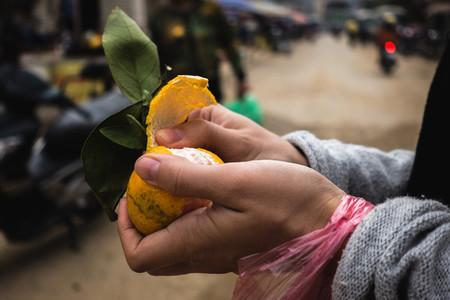 Peeling fresh tangerine