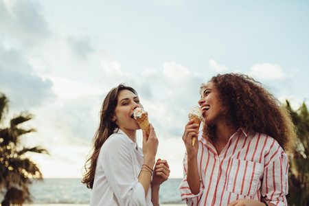 Woman friends eating ice cream together