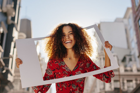 Attractive woman with photo frame