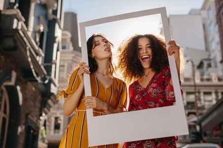 Beautiful women with a blank photo frame