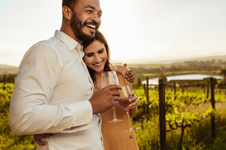 Couple spending time together on a romantic date in a vineyard