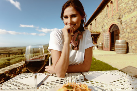 Portrait of a smiling woman drinking wine