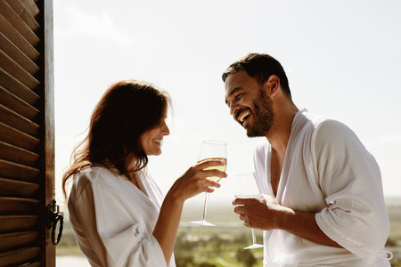 Couple talking over a glass of wine at home