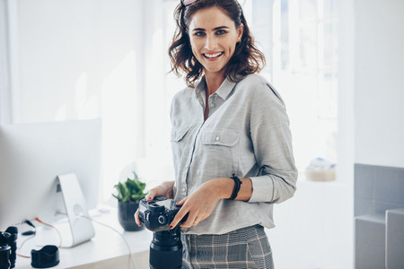 Confident female photographer