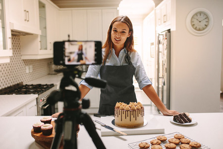 Woman vlogger recording video for food channel