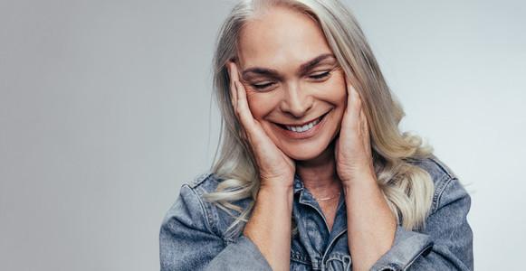 Senior woman loving her skin
