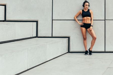 Fit woman posing sports wear