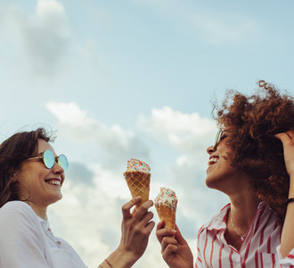 Friends with icecream enjoying together