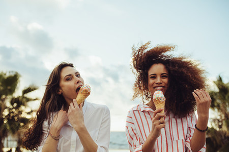 Friends enjoying eating ice cream