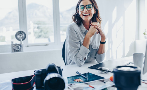 Female photo editor sitting at her desk