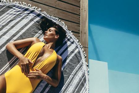 Woman relaxing in stylish swimwear