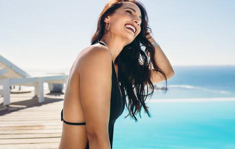 Woman enjoying at resort poolside