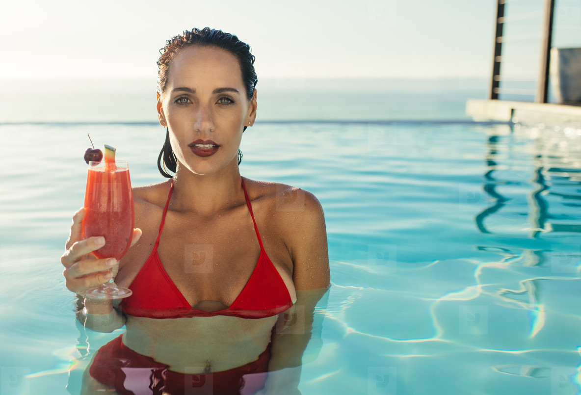 60323da4e2a Photos - Woman inside a pool with a drink - YouWorkForThem