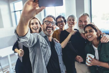 Business people taking a selfie