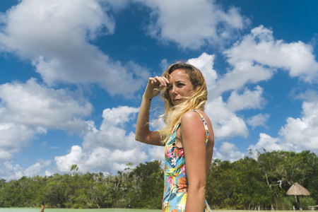 Woman against cloudy sky on resort