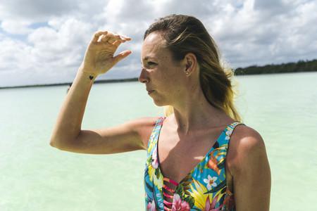Woman against cloudy sky on beach