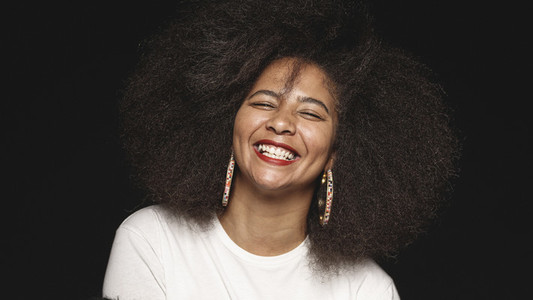 Portrait of a woman in afro hairstyle laughing