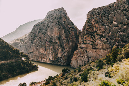 Bridge over de river among rock mountains in south of Spain