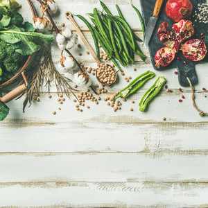 Winter vegetarian food cooking ingredients over white wooden background