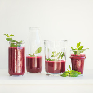 Fresh morning beetroot smoothie or juice in glasses square crop