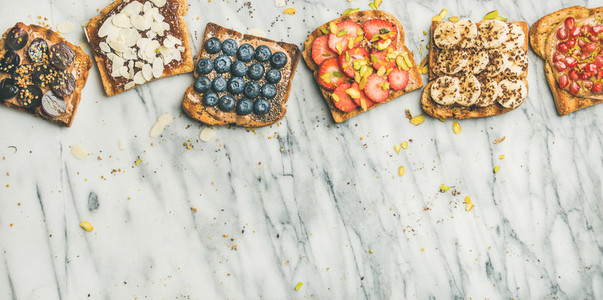 Vegan whole grain toasts with fruit seeds nuts copy space