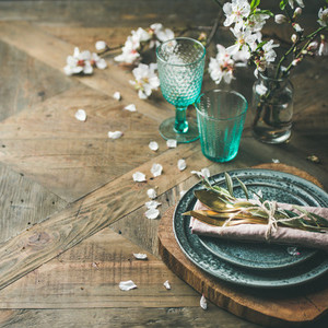 Spring Easter Table setting over vintage wooden background square crop