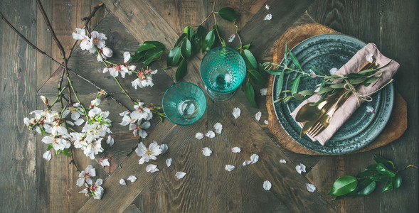 Flat lay of Spring Easter Table setting with almond blossom flowers