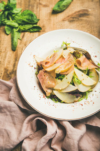 Summer salad with smoked turkey ham and pear