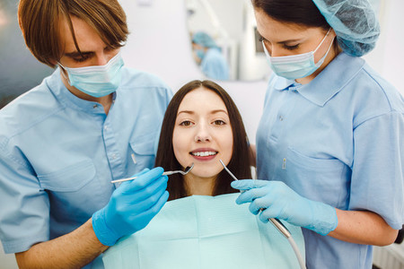 The girl on reception at the dentist with assistant