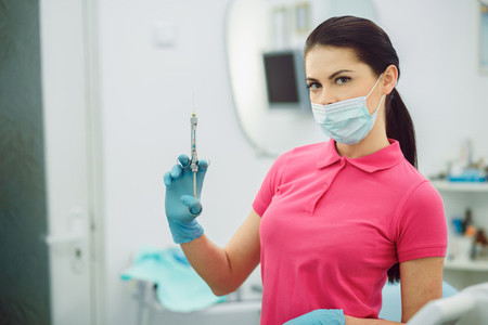 Dental anesthesia on the background of the patient