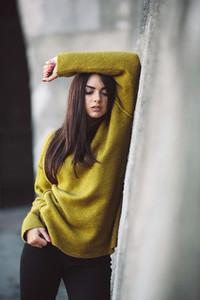 Fashion girl posing against wall