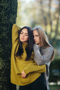 Two girls posing in the park