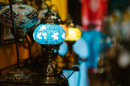 Inlaid lamps stand on a table