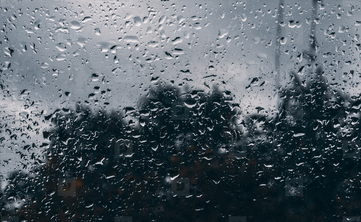Rain drops on window glasses surface with cloudy background   Natural Pattern of raindrops isolated on cloudy background