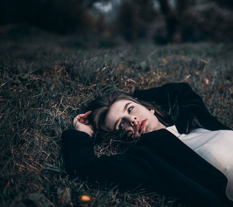 Girl on dark grass